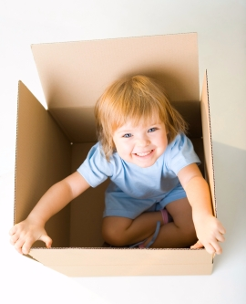 Happy young girl in box