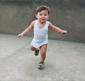 toddler-running-at-camera-concrete-background-e1511299809660.jpeg